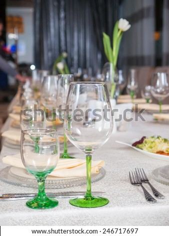 Served table in restaurant  ready for a party - stock photo