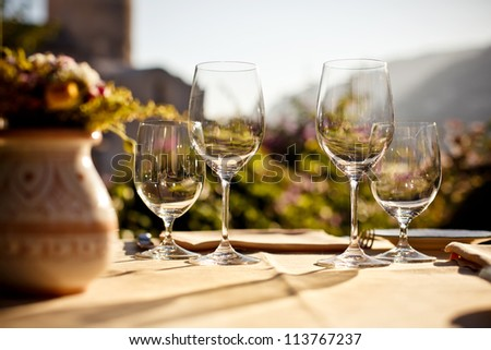 Served table set at summer terrace cafe - stock photo