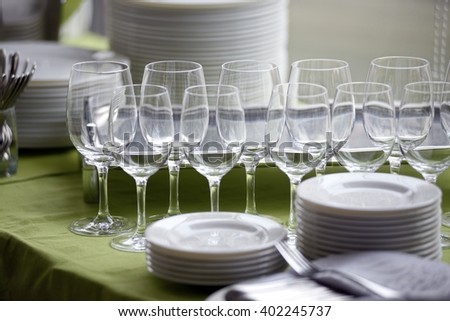 Served table with empty glasses and plates - stock photo