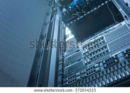 Server and array disk storage in data center with depth of field in cool tone  - stock photo