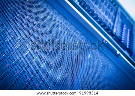 Server rack cluster in a data center (shallow DOF; color toned image) - stock photo