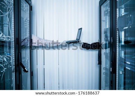 server room and data center, Network Engineer transmits laptop - stock photo