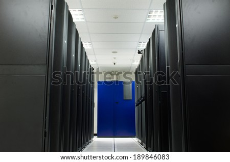 Server room with black Rack and blue Air condition - stock photo