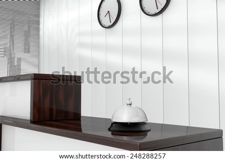 Service Bell over Wooden Reception Desk  - stock photo
