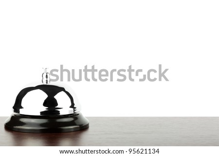Service bell ring on the wooden desk - stock photo