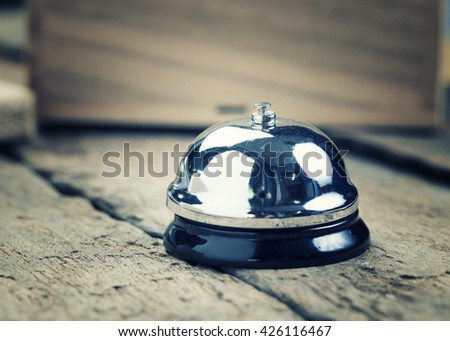 Service bell ,Service bell on the wooden table - vintage filter. - stock photo