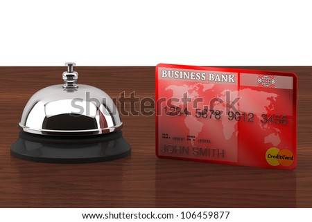 Service bell with Credit Card on a wooden desk - stock photo