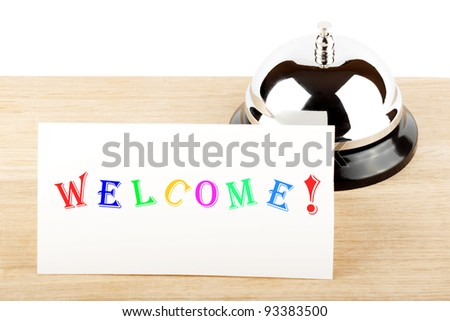 Service Bell with Welcome Sign at Hotel Desk - stock photo