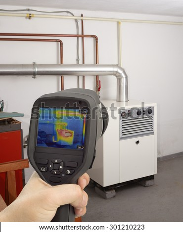 Service Check of Gas Furnace with Thermal Camera - stock photo