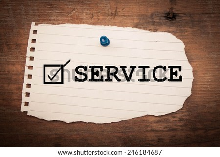 service checkmark on turn note paper - stock photo