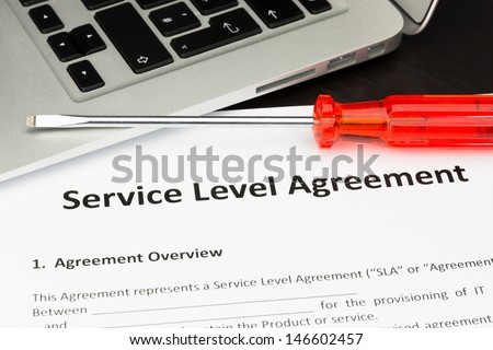 Service Level Agreement Contract with Screwdriver - stock photo