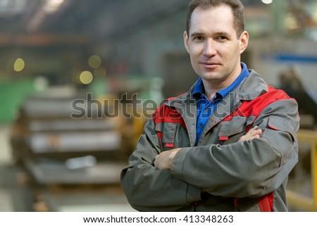 Service man worker at factory workshop background - stock photo