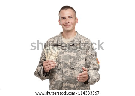 Serviceman with money extends his hand - stock photo