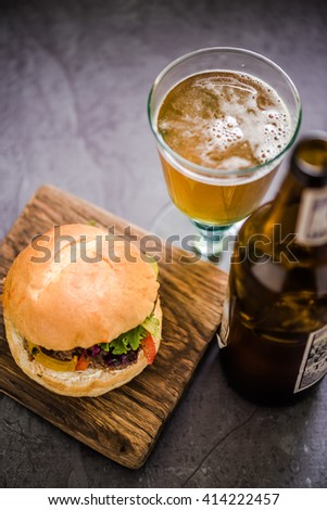 serving beef burger with local artisan Ale beer, gastro pub - stock photo