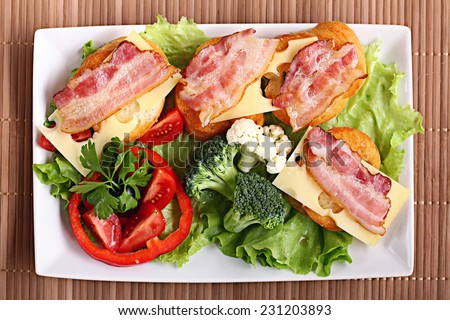 Serving breakfast toast with bacon and herbs - stock photo