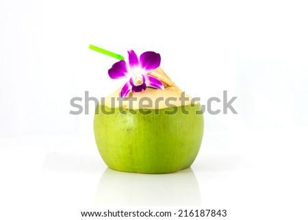 Serving coconut water and decorating orchid flower - stock photo