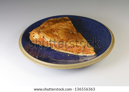 Serving dish with a typical Galician pie, Spain - stock photo