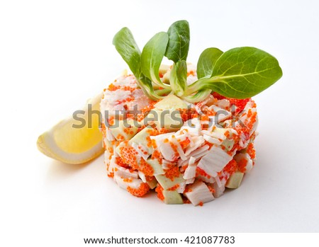 serving fresh crab salad on a white background - stock photo