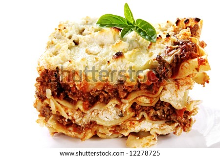 Serving of home-baked lasagne, garnished with basil. - stock photo