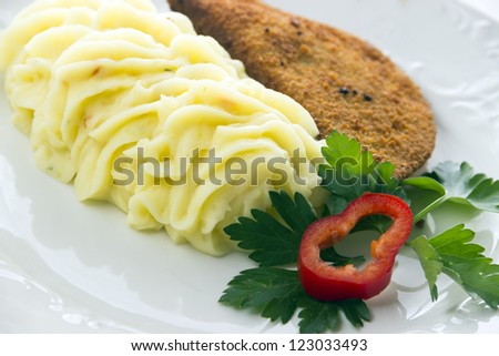 Serving of mashed potatoes with decoration/Mashed potatoes and fried cheese - stock photo