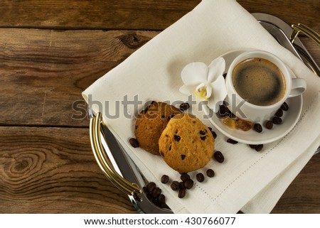 Serving tray with two cookies, coffee cup and white orchid. Coffee break. Morning coffee and breakfast cookie. Homemade cookies and cup of coffee.    - stock photo