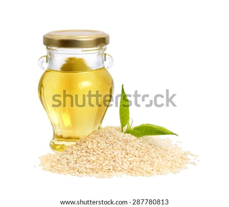 Sesame oil with seeds. Isolated on white background. - stock photo