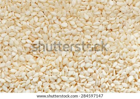 Sesame seeds close-up background.  - stock photo