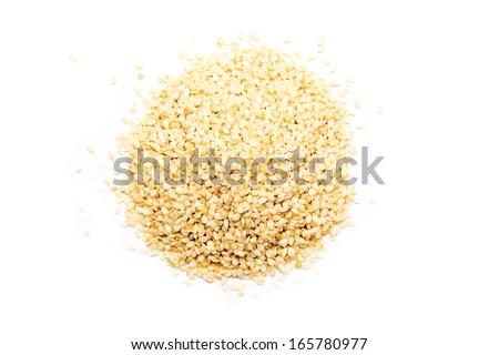 Sesame Seeds Pile On White Background - stock photo