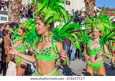 Sesimbra, Portugal. February 17, 2015: Brazilian Samba dancers called Passistas in the Rio de Janeiro style Carnaval Parade. The Passista is one of the sexiest performers of this event - stock photo