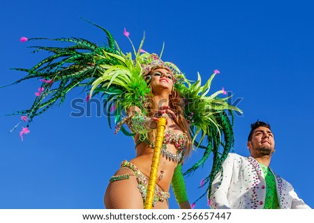 Sesimbra, Portugal. February 17, 2015: Liliana Antunes and Daniel Gregorio, stars from the Secret Story Reality Show, performing on top of a Float in the Rio de Janeiro Brazilian style Carnaval Parade - stock photo