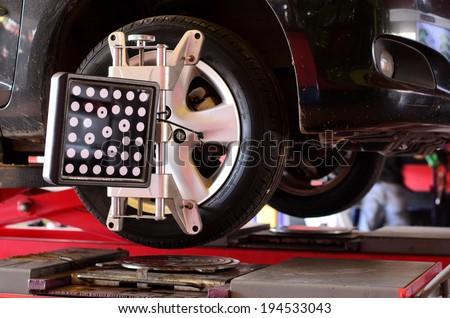 Set against the Center wheel, Wheel Aligner - stock photo