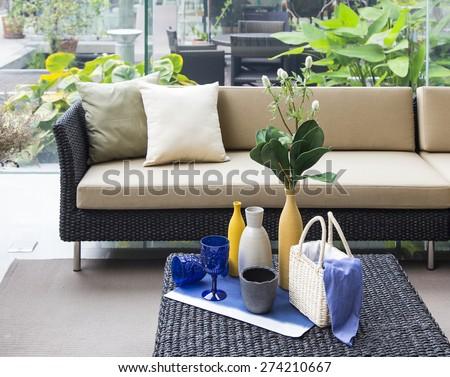 set decoration with wicker sofa  - stock photo