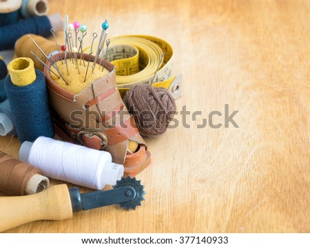 Set for needlework on a wooden background - stock photo