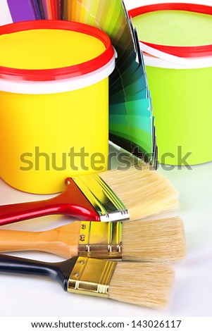 Set for painting: paint pots, brushes, palette of colors close up - stock photo