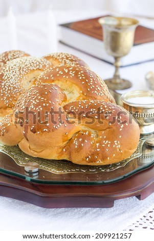 Set for Shabbat with challah bread on a wooden table - stock photo