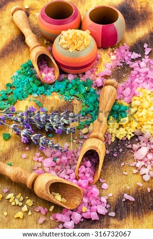 Set for Spa.Sea salt for Spa relaxation treatments on the background of wooden scoops - stock photo