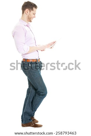 Set for success thanks to digital tech - full length shot of a confident young businessman working with a modern tablet pc - stock photo
