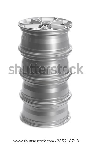 Set in a stack of steel alloy car rims on a white background. - stock photo