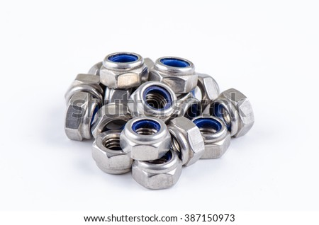 Set metal Hex Nut with Nylon Insert isolated on white background - stock photo