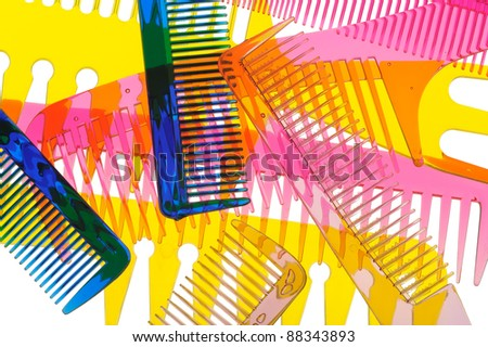 Set multi-coloured transparent combs. It is photographed on a gleam. It is isolated on a white background - stock photo