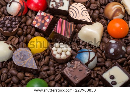 Set of a various chocolate pralines and coffee beans - stock photo