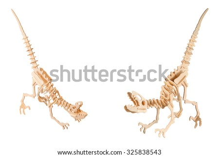 Set of a wooden dinosaurs isolated on a white background - stock photo