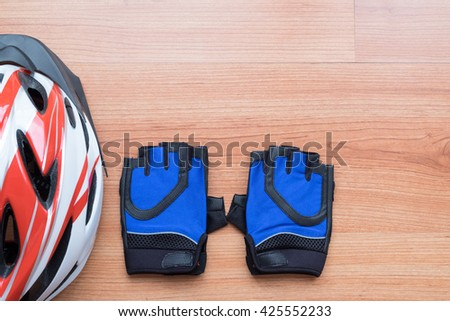 Set of accessories for sport cycling / sports equipment cycling - Helmet and gloves - stock photo