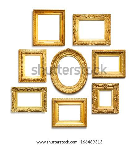 Set of antique golden frames on white background - stock photo