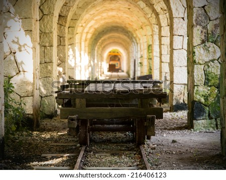 Set of arches and ancient trolley in Mexico - stock photo
