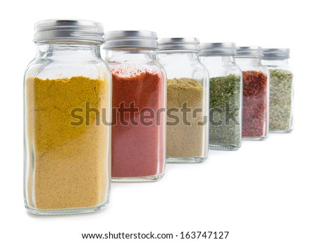 Set of assorted colorful powder spices in glass bottle isolated on white background    - stock photo