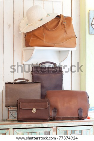 Set of beautiful leather bag and handbag - stock photo