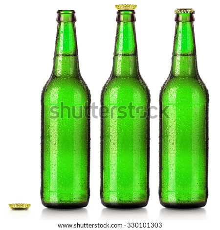 Set of beer's bottles with frosty drops isolated on white background - stock photo