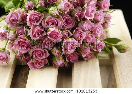 Set of Big Roses Bouquet on wooden mat - stock photo