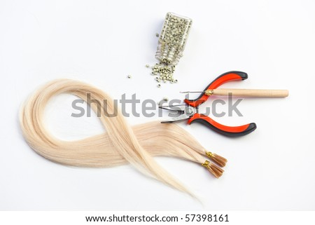 Set of blond hair extension tools - stock photo